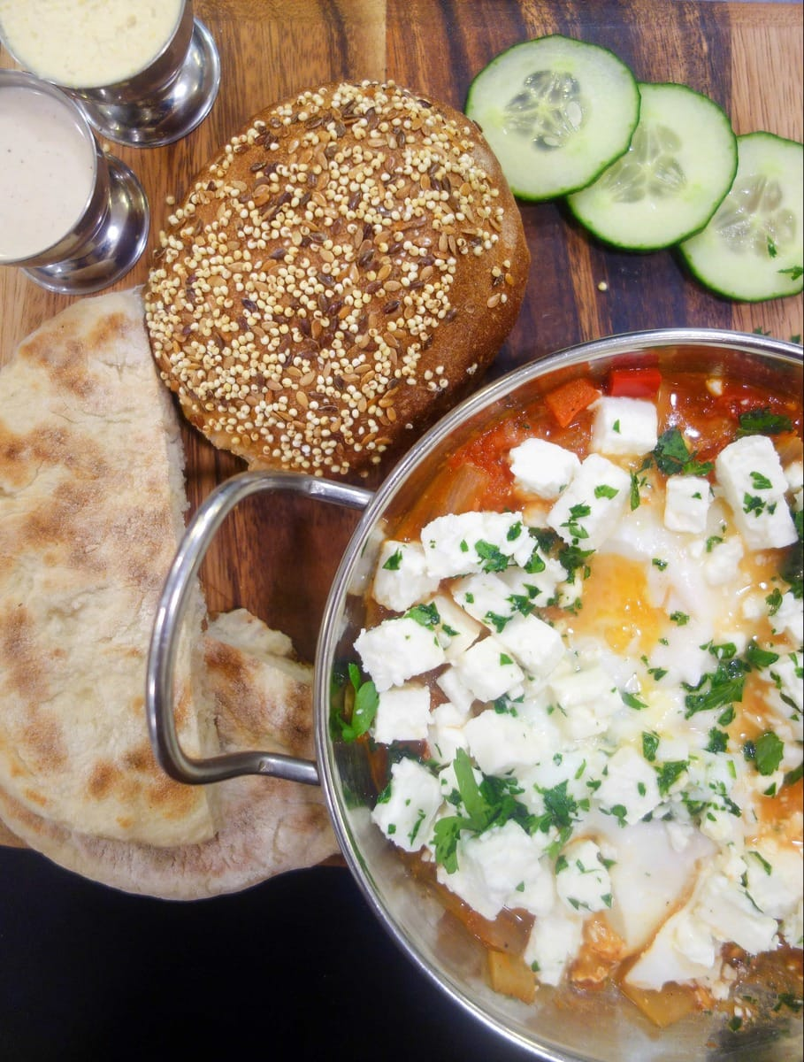 Cafe Loren is a middle eastern coffee shop in Camden Market specialising in all day shakshuka. Baked eggs in a tomato sauce with bread for dunking. More details on www.notsobasiclondon.com