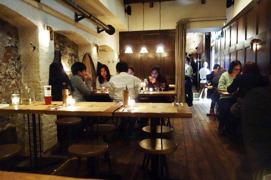 Flat Iron is London's trendiest steak place that is really good value for money. Served on your own hot plate with a salad and your own meat cleaver and free popcorn for just £10. More on www.notsobasiclondon.com