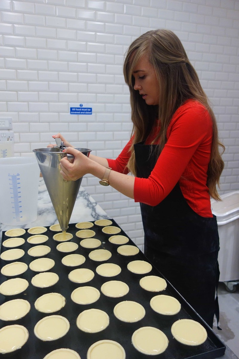 Top Tips For Dining Out In London (Picture of woman making Pastel de Nata)