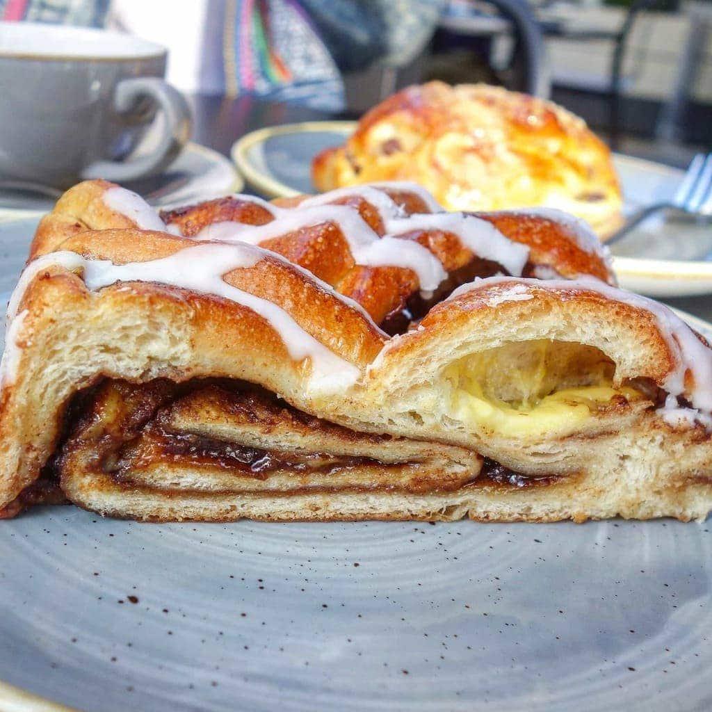London's Best Cinnamon Buns (Image of a cinnamon bun from Ole & Steen)