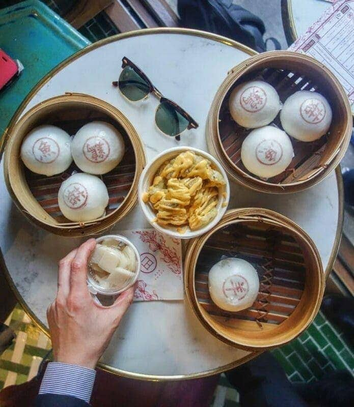London's Best Restaurants To Dine Alone (Image of table of buns at Bun House)